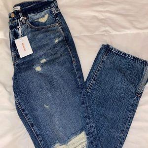 Good American distressed split hem jeans
